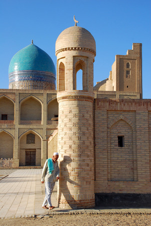 A man coming out of a mosque in Bukhara