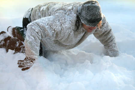 Man plays and depicts a dog in the cold Stock Photo