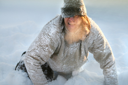 steam mouth: Man plays and depicts a dog in the cold. Steam comes out of his mouth