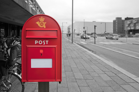 Mailbox in the background of a black and white street, Copenhagen. Stock Photo