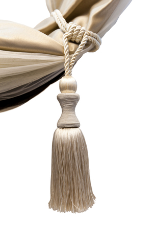 Brush for picking up curtains - kutasy from natural beige silk on a white background. Interior Design