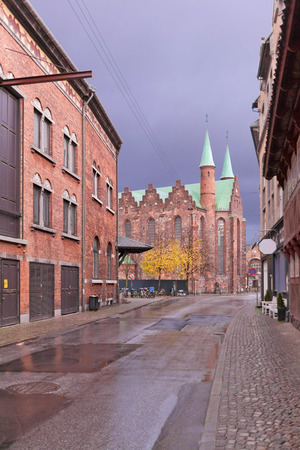 The back wall of the Aarhus Theater in the 19th-century buildings of the red brick and the medieval cathedral of Ã…rhus. Denmark
