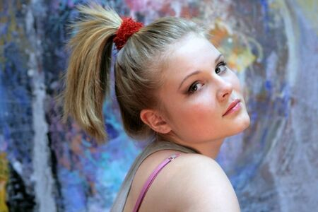 Portrait of a natural blonde. Teen Girl with a High Ponytail - Youth Hairstyle
