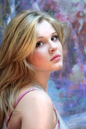 Portrait of a natural blonde. Teen girl on a colorful background