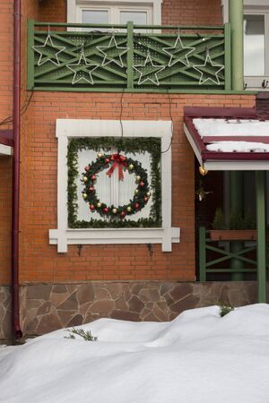 Brick townhouse, cottage with decorations for the New Year