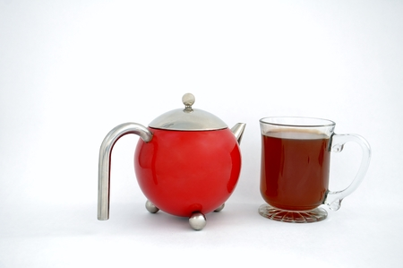 teapot and mug of tea isolated on a white background