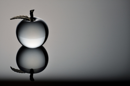 Isolated Glass Apple on a Grey background
