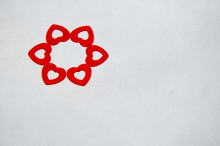 circle created with red heart shaped confetti