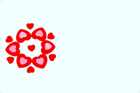 flower created with red and pink heart shaped confetti Stock Photo