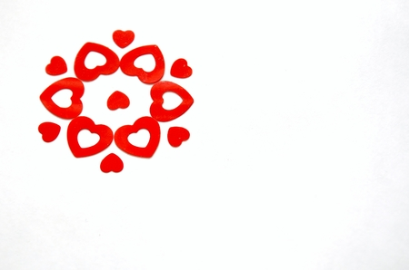 flower created with red heart shaped confetti