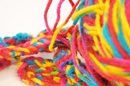 multi colored yarn isolated on a white background closeup Stock Photo