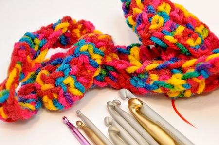 crochet hooks and multi colored yarn