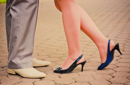 Feet in footwear of the groom and the bride photo