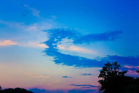 Heart shape made of clouds on a sunset sky. Love, romance, religion concepts photo
