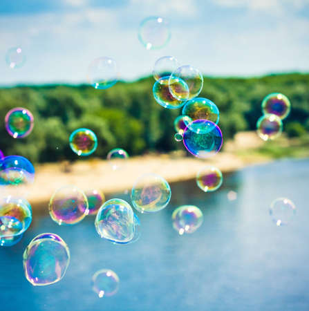 blowing bubbles: Background from bright soap bubbles Stock Photo