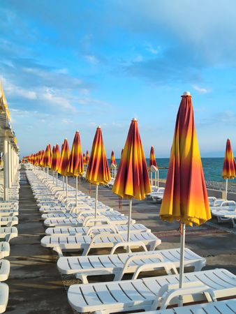pass away: A lot of yellow summer umbrellas. It`s look like infinity