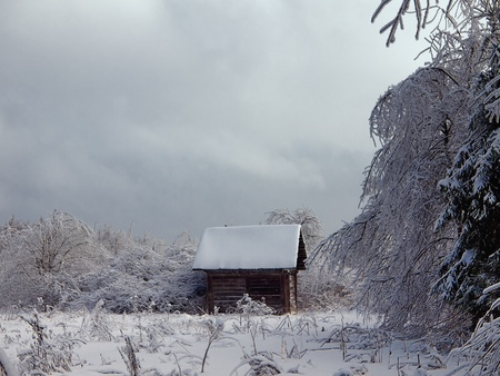 Winter landscape with small wooden house photo