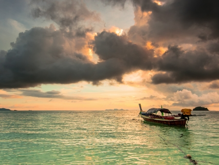Woden boat at sunrise  Ko Lipe island in Thailand photo