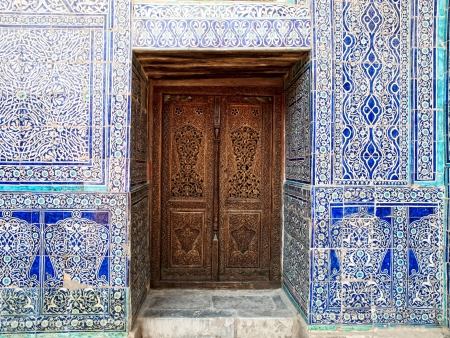 Door and wall with traditional floral decoration in Khiva. Uzbekistan photo