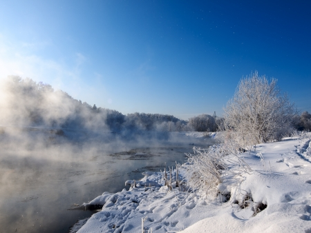 River and frozen trees at winter morning in Russia photo