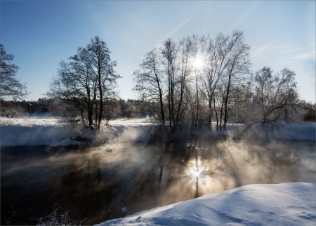 Winter landscape with foggy river photo