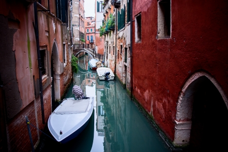 Canal with boat in Venice  Italy photo