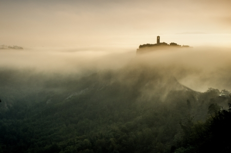 Ancient Civita di Bagnoregio town in a morning fog  Italy Stock Photo - 16797383