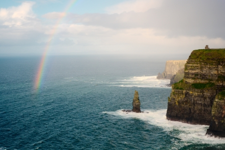 Rainbow above Cliffs of Moher and O Stock Photo