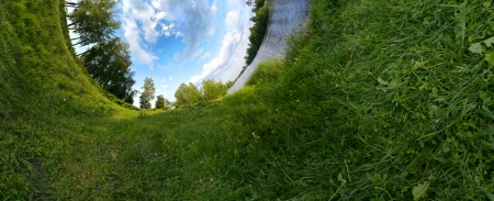 Panoramic photo looking like inverted green planet. Ecology concept. photo