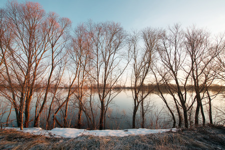 thawed: Early spring landscape. Sunrise on a flooded river with thawed ice. Stock Photo