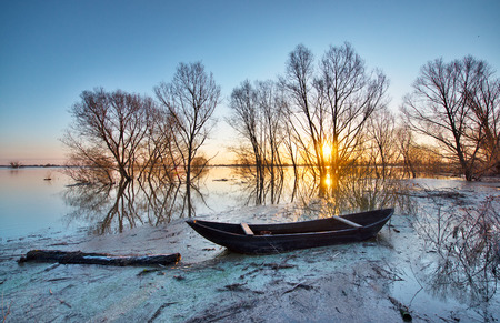 oka: Wooden boat on a flooded river  Early spring landscape  Stock Photo