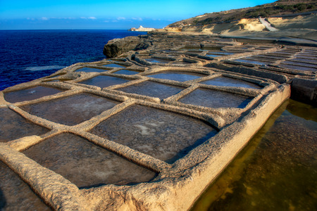 manmade: Manmade salt pools on a Gozo coastline