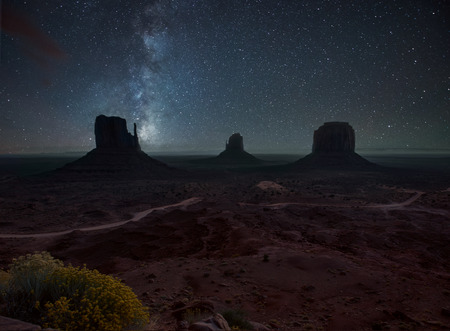 star night: Milky Way and bright stars above Monument Valley. USA Stock Photo