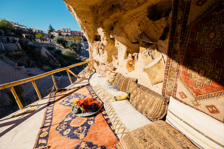 dwelling: Cave dwelling and columbariums interior at the valley of Uchisar town. Cappadocia, Turkey.