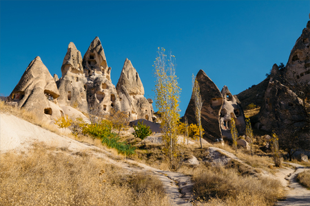 dwelling: Cave dwelling and columbariums at the valley of Uchisar town. Cappadocia, Turkey. Stock Photo