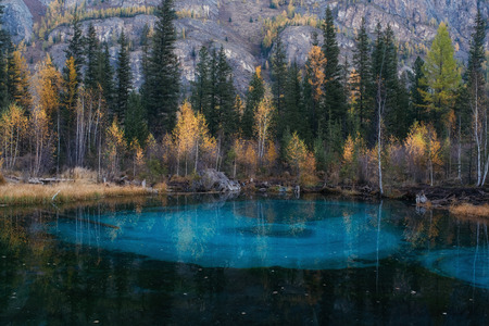 Blue geyser lake in Altay mountains. Blue because of the clay at the bottom. Stock Photo