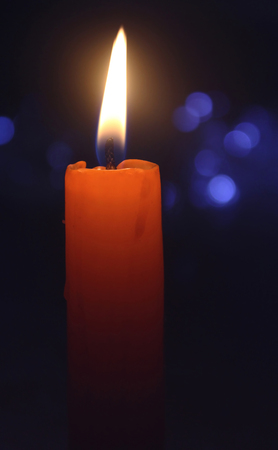 Candle with christmas lights Stock Photo