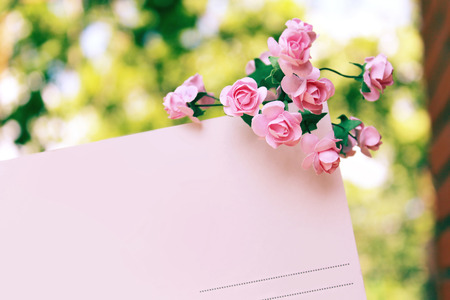 Decorative flowers on letter card Stock Photo