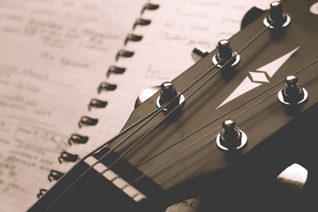 Classical guitar with and notebook, songwriting