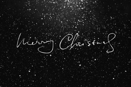 Hand drawn words Merry Christmas, holiday background