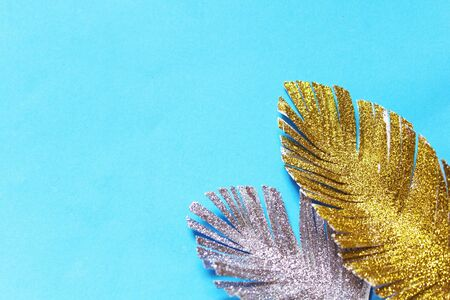 Colorful shining paper feathers, background Фото со стока