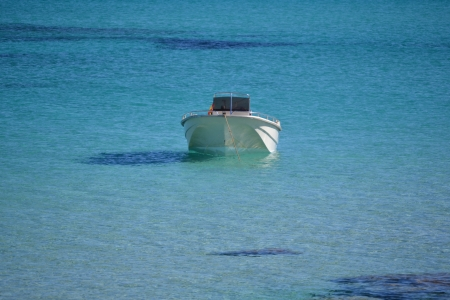 boat tethered to the sea shore photo