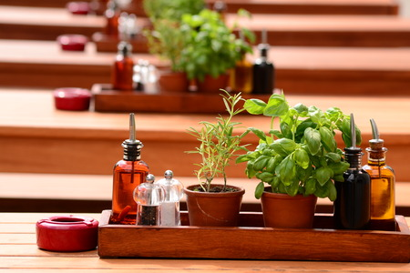molhos:  Basil, oil and sauces are on the table