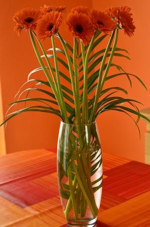 glass vase: Orange flowers in a glass vase Stock Photo