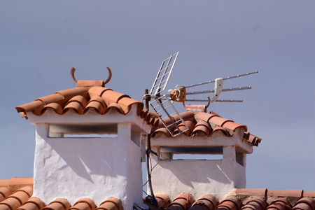 whitewash: antenna on a tiled roof Stock Photo