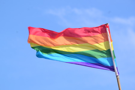 nontraditional: rainbow flag on a background of blue sky