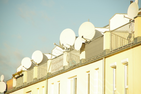 sattelite: Satellite dishes on the roof of an apartment house