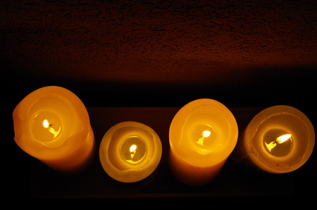four lighted candles, top view