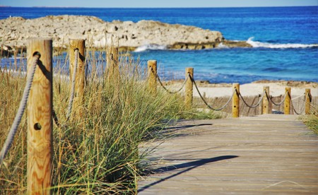 passage: wooden passage to the blue sea