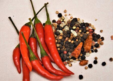 Fresh and dry mini chili red, black, peas, and coarse sea salt
